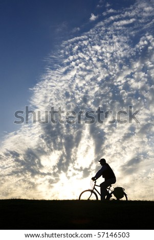 Silhouette of a man riding his bicycle