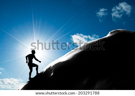 Silhouette of a man running up hill to the peak of the mountain. Trekking, active lifestyle, motivation, strength - stock photo
