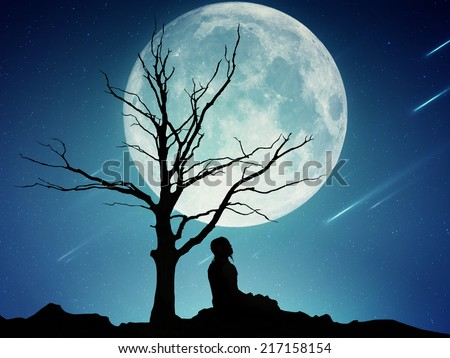 Silhouette of a man sitting under the tree meditating isolated on beautiful background of moon, earth, night skyline, falling stars. Body vitality, human spirit wellbeing concept. Alternative medicine - stock photo