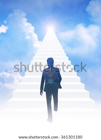 Silhouette of a man step on to stairway leading up to bright light above the sky. Success, motivation, determination concept - stock photo