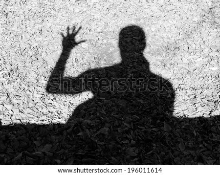 Silhouette of a man that welcomes - stock photo
