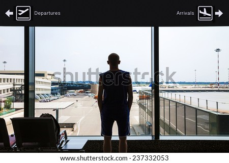 Silhouette of a man waiting at the airport