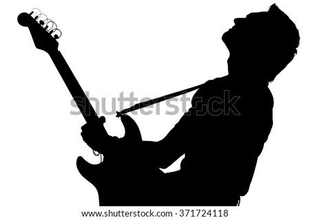 Silhouette of a man with an electric guitar.