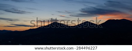 silhouette of a mountain range at sunset. Ukrainian Carpathians