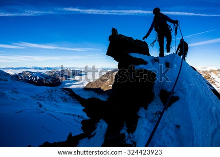 Silhouette of a mountaineer during morning ascent