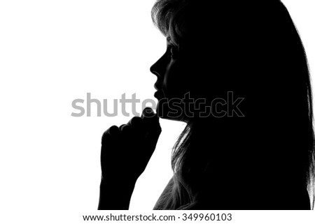 silhouette of a pensive woman on a white background