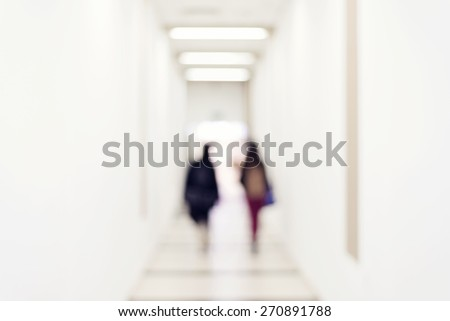 Silhouette of a people walking in a tunnel to light. - stock photo
