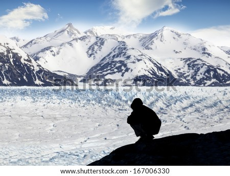 Silhouette of a person admiring beautiful view of glacier and mountains, Glacier Grey, Torres del Paine National Park,  Chile,