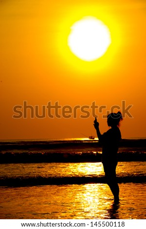 Silhouette of a photographer - stock photo