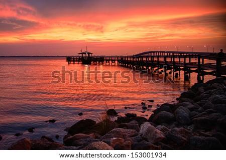 Silhouette of a pier in the Atlantic ocean, Merritt Island, Brevard County, Florida, USA - stock photo