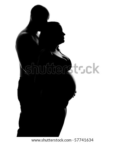 silhouette of a pregnant woman and her partner