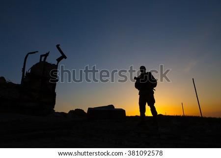 Silhouette of a rebel soldier in Ukraine - stock photo