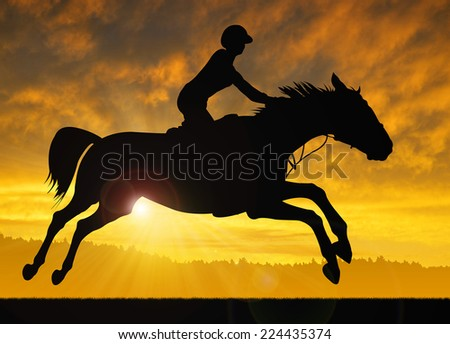 silhouette of a rider on a running horse in the sunset - stock photo