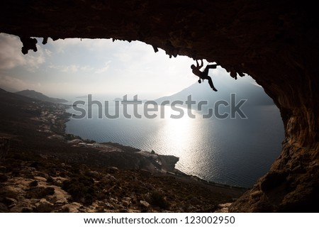 Silhouette of a rock climber at sunset. Kalymnos Island, Greece. - stock photo