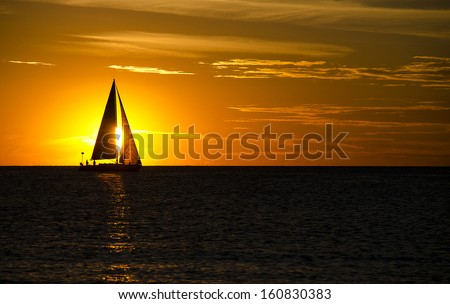 silhouette of a sailboat on Lake Michigan at sunset