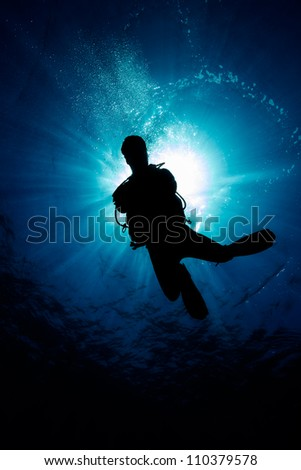 Silhouette of a SCUBA Diver - stock photo