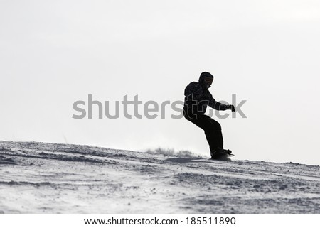 Silhouette of a skier on the hill. Sport and active life - stock photo