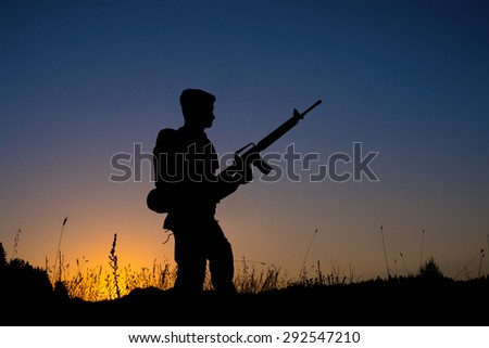 Silhouette of a soldier - stock photo