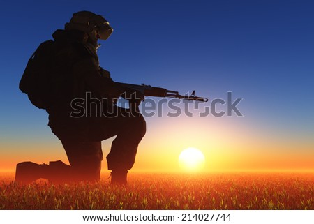 Silhouette of a soldier against the sun. - stock photo