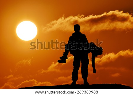 silhouette of a soldier officer man holding on hands girl woman
