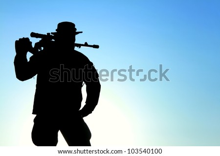 silhouette of a soldier with a background of blue sky with the sun