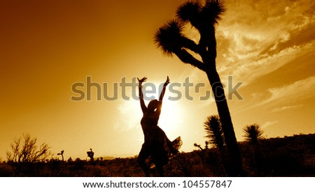 Silhouette of a soulful woman in the desert.