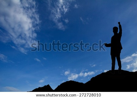 Silhouette of a success business. Shot outdoor at sunrise - stock photo