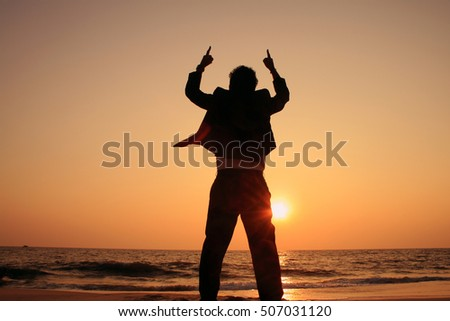 Silhouette of a successful executive during the sunset in a beach