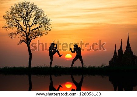 Silhouette of a thai's boxing at sunset - stock photo