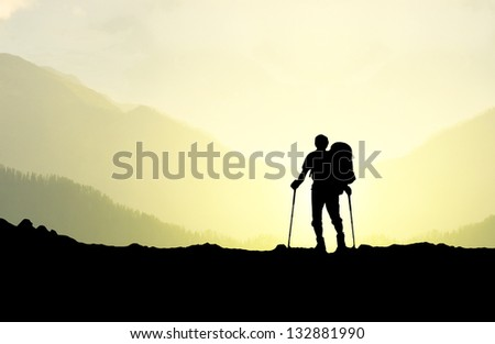 Silhouette of a tourist in the mountains. Sport and active life