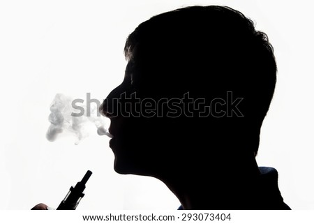 Silhouette of a vaping man with e-cigarette - stock photo
