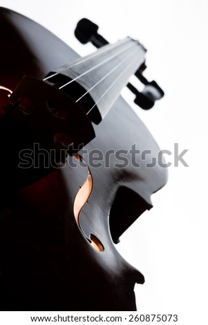 Silhouette of a violin selective focus
