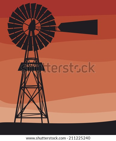silhouette of a water pumping windmil