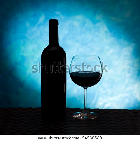 Silhouette of a wine bottle and glass