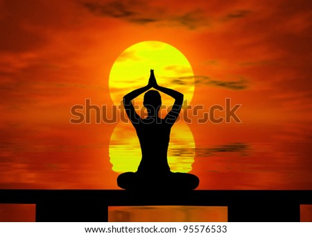 Silhouette of a  woman doing yoga at the sunset