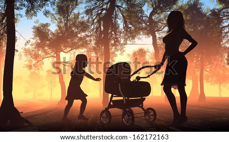 Silhouette of a woman with a baby carriage in the park.