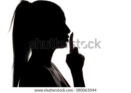 silhouette of a woman with a finger in front of lips on a white background - stock photo