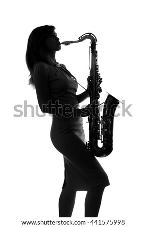 silhouette of a woman with a saxophone