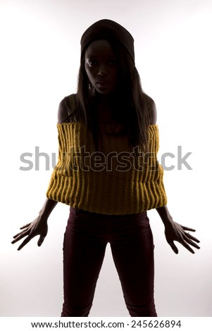 silhouette of a young African girl - stock photo