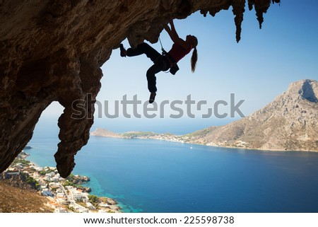 Silhouette of a young female rock climber on a cliff. Kalymnos Island, Greece  - stock photo