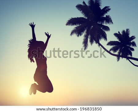 Silhouette of a Young Woman Jumping with Excitement - stock photo