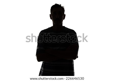 Silhouette of adult man on white background - stock photo