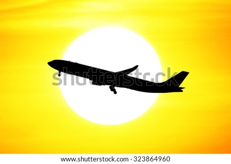 Silhouette of Air Plane sunset background