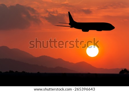 Silhouette of Airplane on big sunset
