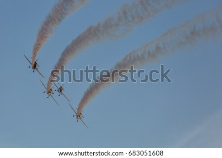 Silhouette of airplane on sunset with smoke in background