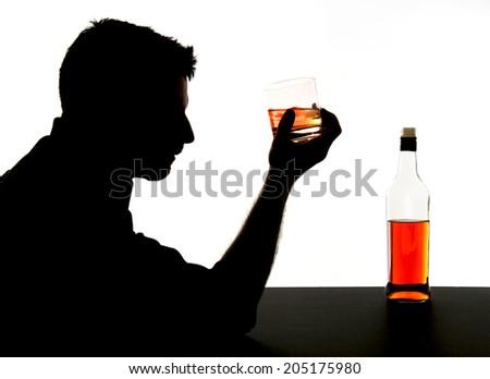 silhouette of alcoholic drunk man drinking whiskey bottle feeling depressed falling into addiction problem isolated on white background - stock photo
