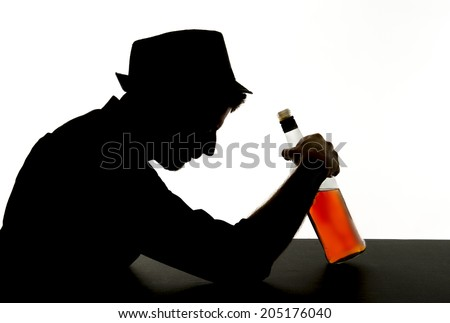 silhouette of alcoholic drunk young man with hat  drinking whiskey bottle feeling depressed falling into addiction problem isolated on white background - stock photo