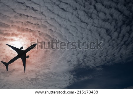 Silhouette of an airplane and sky - stock photo
