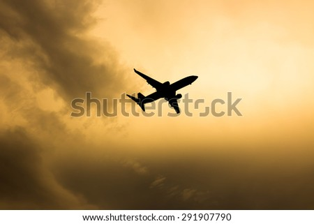 silhouette of an airplane at sunset ,early in the evening