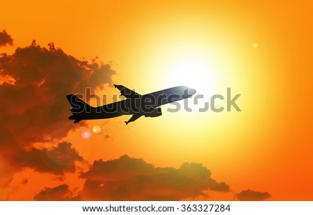 Silhouette of an  airplane taking off , sunset evening sky - stock photo